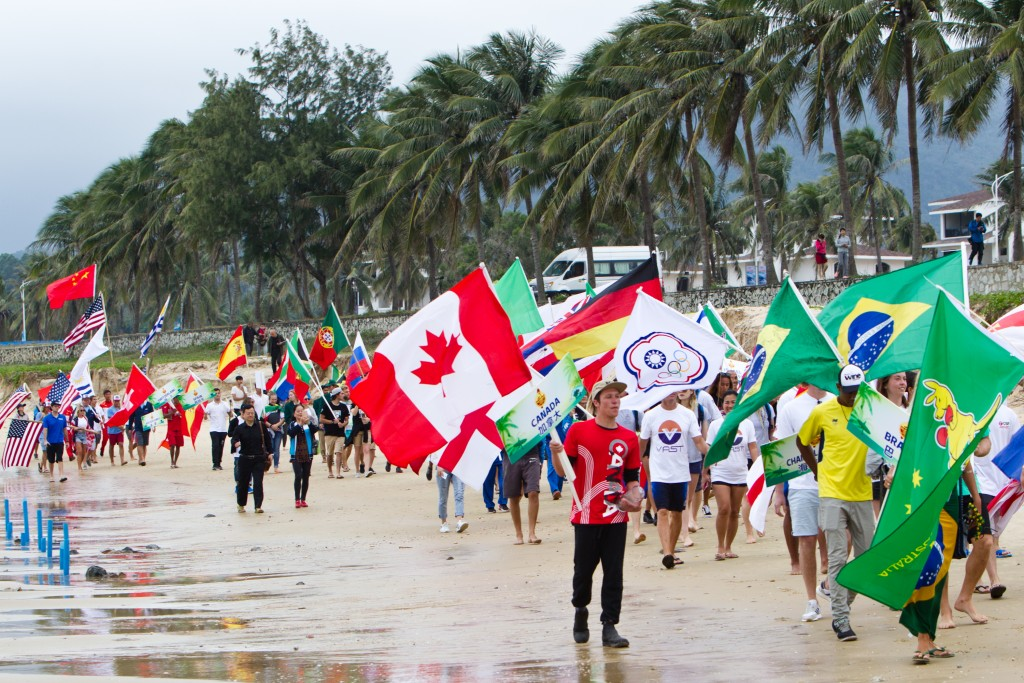 The festive Parade of Nations heads down the beach at Riyue Bay en route to the Opening Ceremony stage. Photo: ISA / Tim Hain