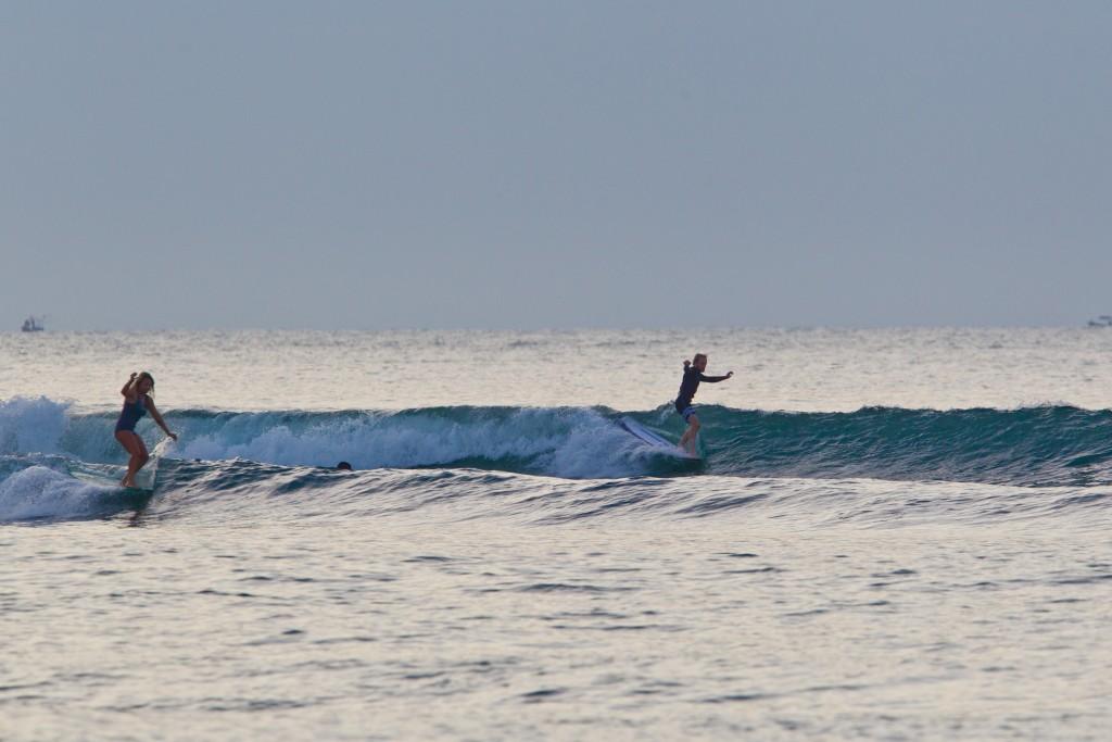 Simultaneous hang fives during a warm-up session at Riyue Bay. Photo: ISA / Tim Hain