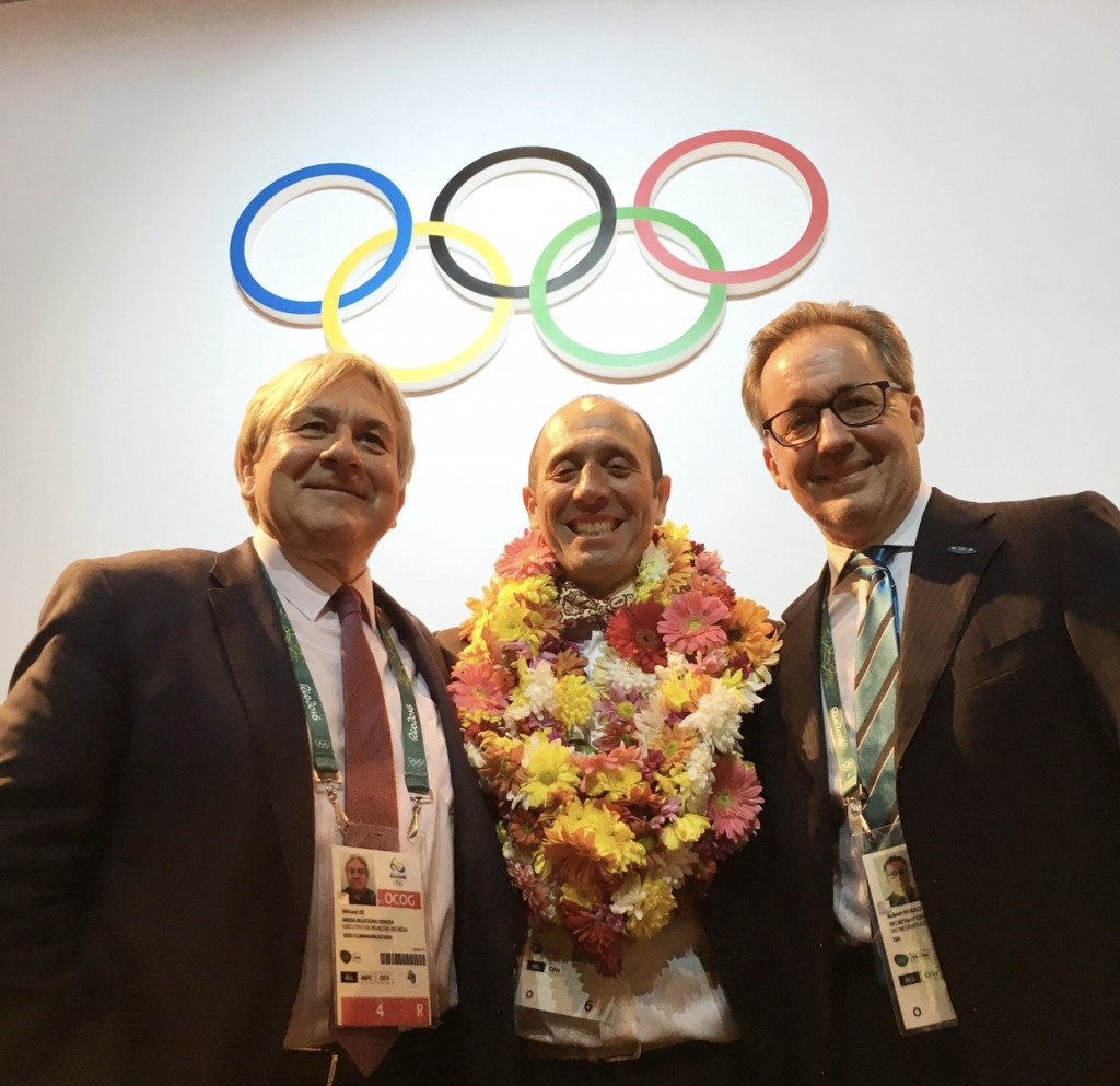 Vero Communications' Mike Lee (left) alongside ISA President Fernando Aguerre (center) and ISA Executive Director Robert Fasulo in Rio de Janeiro following the IOC's vote to include Surfing in the Tokyo 2020 Olympic Games.