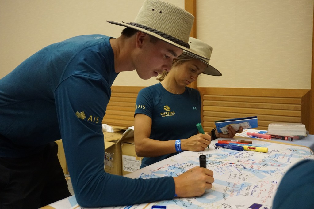 Team Australia shares their 'TRUTH' messages with the other competing nations. Photo: ISA / Borja Irastorza