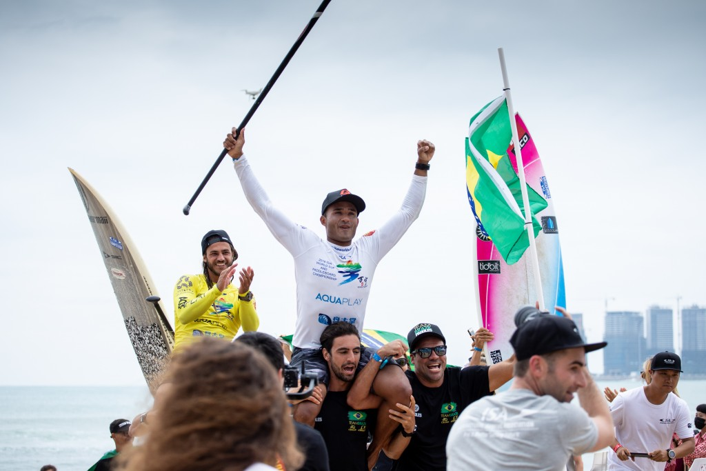 Brazil's Luiz Diniz soaks his in second ISA SUP Surfing Gold. Photo: ISA / Pablo Jimenez