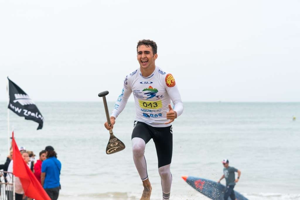 USA's Ryan Funk crosses the finish line as the first-ever Junior Boys SUP Technical Race World Champion. Photo: ISA / Sean Evans
