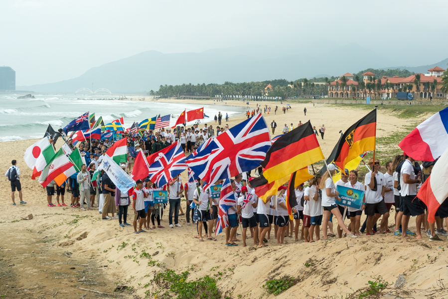 The Parade of Nations marches down the beach of Riyue Bay in Wanning, China. Photo: ISA / Sean Evans