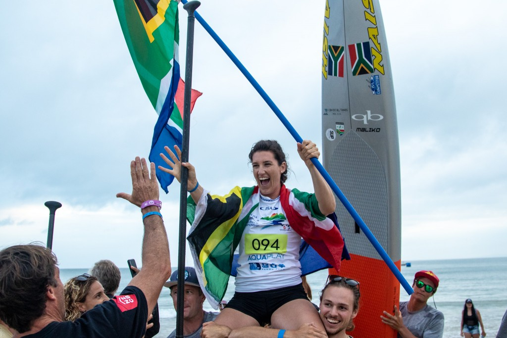 Tarryn King rejoices after earning a historic first-ever SUP Gold Medal for Team South Africa. Photo: ISA / Pablo Jímenez