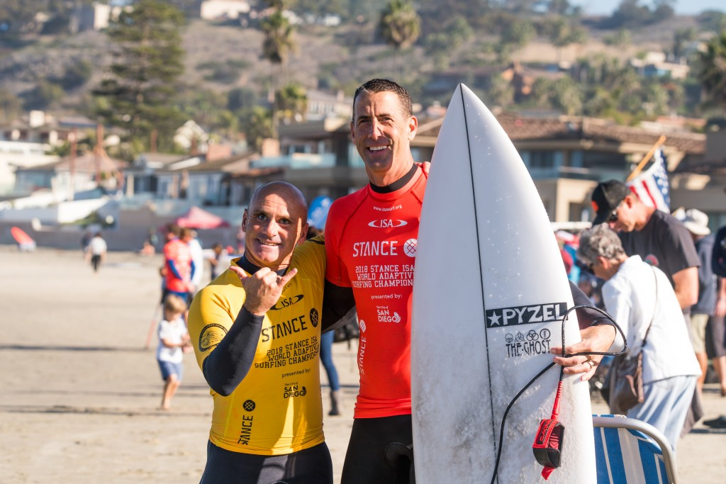 Stance President John Wilson has been joining the volunteers in the water throughout the week., pictured here with Spain's visually impaired copetitor Aitor Francesena. Photo: ISA / Sean Evans