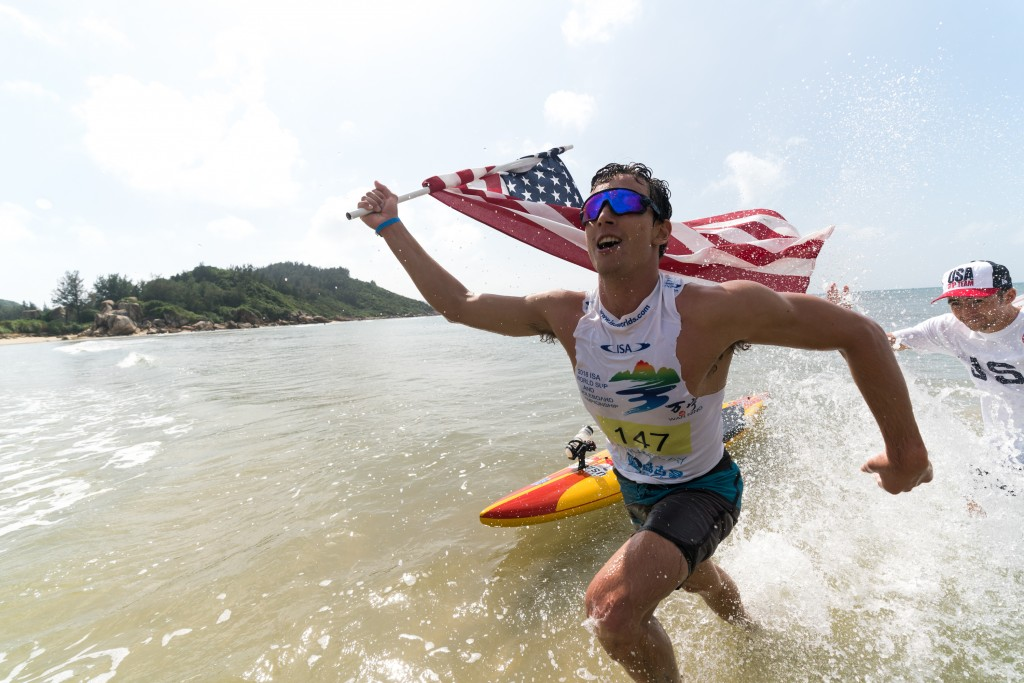 USA's Hunter Pflueger flies his flag with pride as he earns a Gold Medal. Photo: ISA / Sean Evans