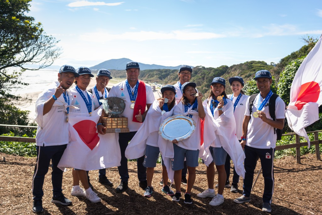Team Japan puts their Gold Medals on display after taking the Team Title at the 2018 ISA World Surfing Games in Tahara, Japan. Photo: ISA / Sean Evans