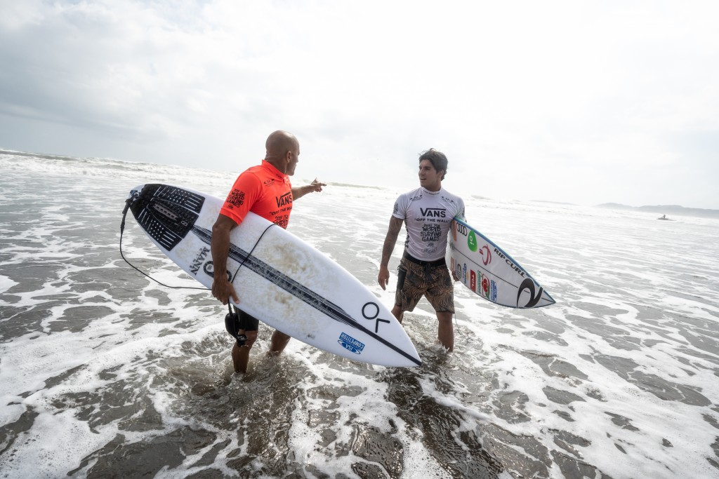 """While speaking about the World Surfing Games, USA's Kelly Slater said, """"It was really fun and great meeting all the countries from around the world here. With all the camaraderie between the teams, this is one of the more fun events that you can surf in."""" Pictured, Slater discusses his heat with Brazil's Gabriel Medina. Photo: ISA / Sean Evans"""