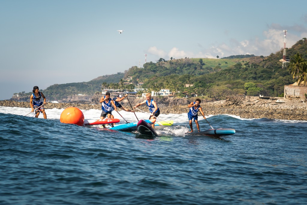 The Men's Technical Semifinal rounds a buoy at El Sunzal, featuring elite paddlers of the sport. Photo: ISA / Sean Evans