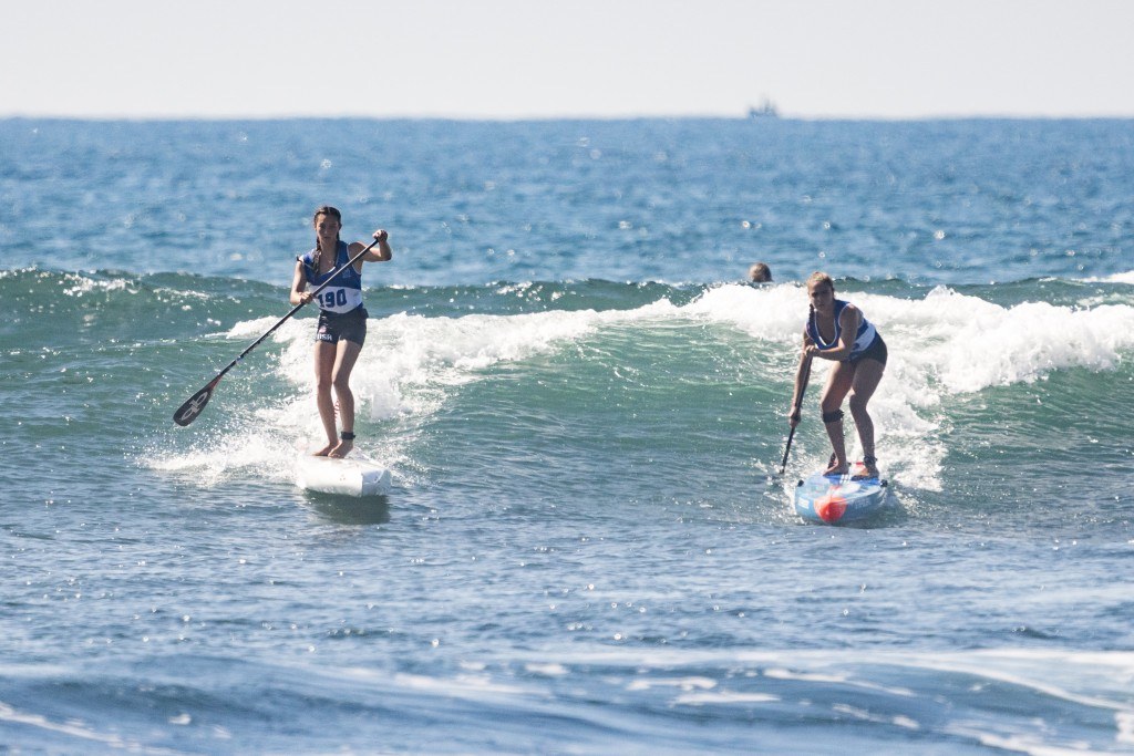 USA's Jade Howson (left) displaying that the future of USA SUP Racing is in good hands with her second consecutive Girl's Junior Gold Medal in the Technical Race, her second of the event after winning Gold in SUP Sprints. Photo: ISA / Ben Reed