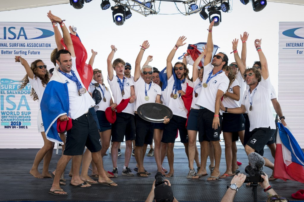 Team France celebrates their breakthrough performance, the first Gold Medal for their nation in the event's eight-year history. Photo: ISA / Ben Reed