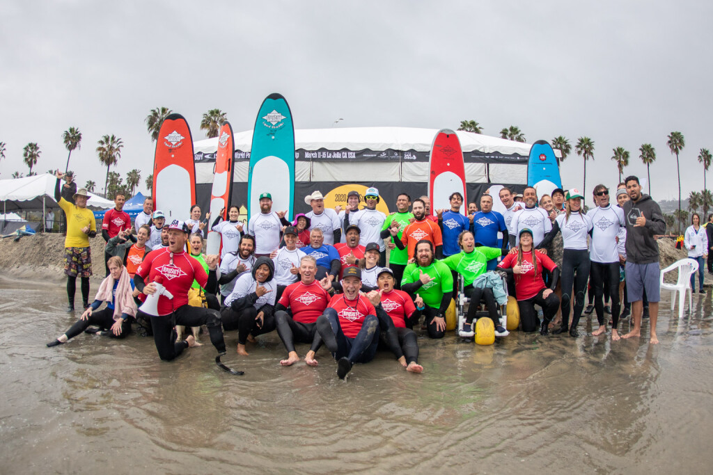 Clinic instructors and participants gather to celebrate the power of Surfing at La Jolla Shores, rain or shine. Photo: ISA / Pablo Jimenez