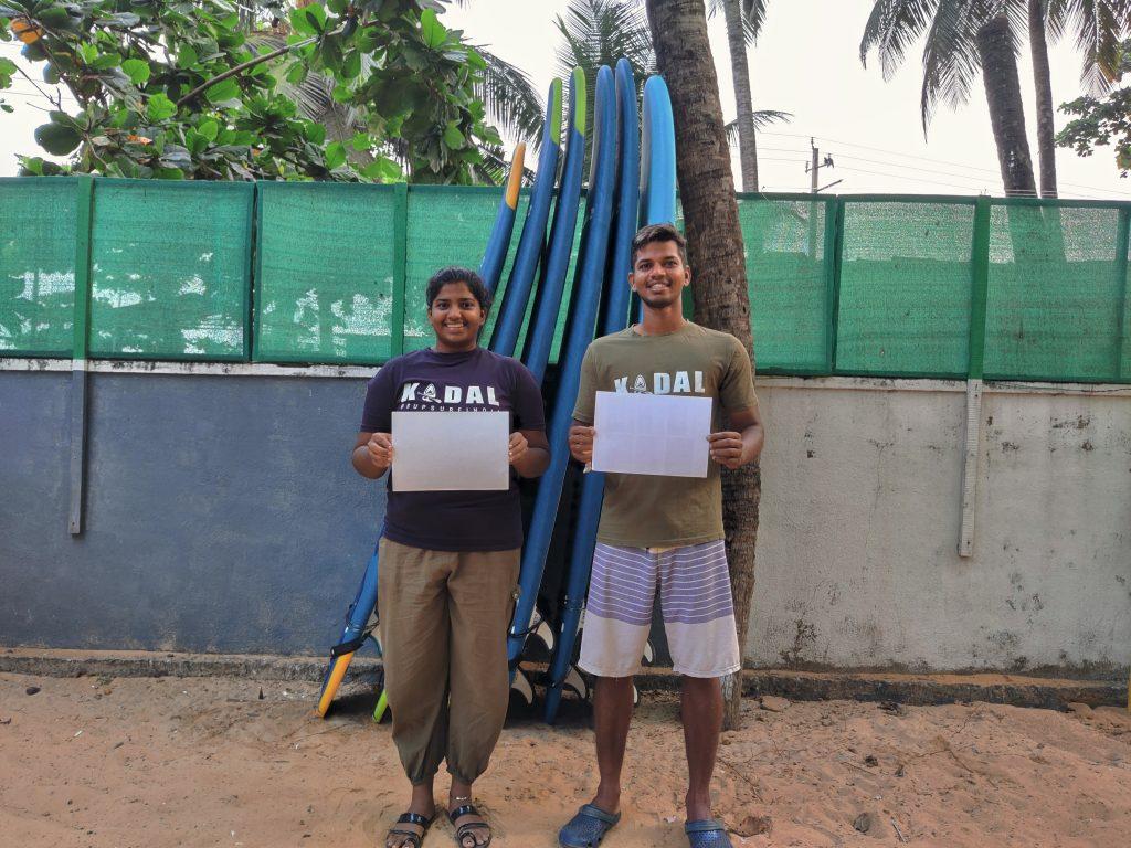 ISA Scholarship ambassador and SUP racer Tanvi Jagadish and Rohan Suvarna display their white cards in India.