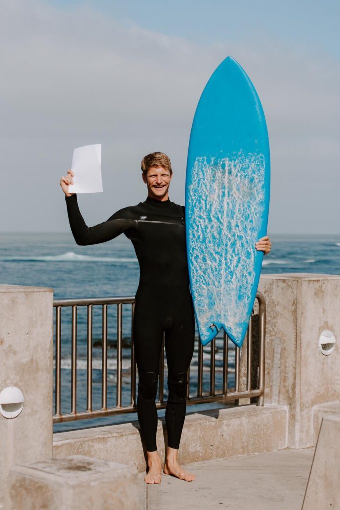 ISA Membership and Development Manager Alex Reynolds holds his white card near ISA headquarters in La Jolla, USA.